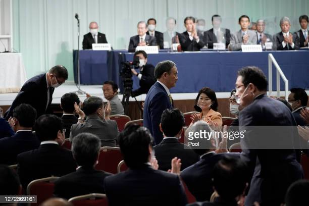 Former Defense Minister Shigeru Ishiba left and former Foreign Minister Fumio Kishida right bow after Japanese Chief Cabinet Secretary Yoshihide Suga...