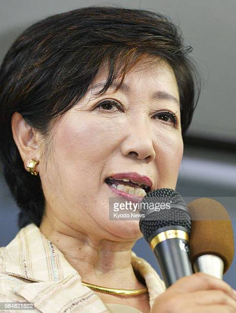 Former defense minister Yuriko Koike speaks to supporters at her election campaign office in Tokyo on July 31 after the media projected she would win...