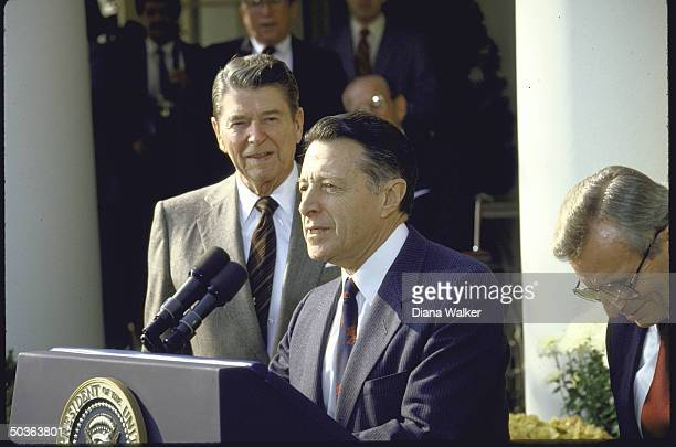 Former Defense Secretary Caspar Weinberger with President Reagan during ceremony to annouce Weinberger's retirement from office Frank Carlucci
