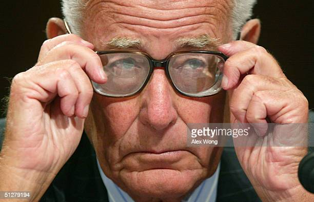Former Defense Secretary Harold Brown listens to opening statements during a hearing before the Senate Armed Services Committee September 9 2004 on...