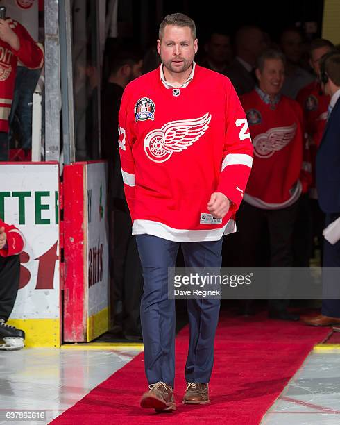 Former defenseman Aaron Ward of the Detroit Red Wings 1997 Stanley Cup Team walks out for the Twenty Year Anniversary celebration night pregame...