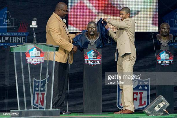 Former defensive end Chris Doleman presented by his son Evan Doleman during the Class of 2012 Pro Football Hall of Fame Enshrinement Ceremony at...