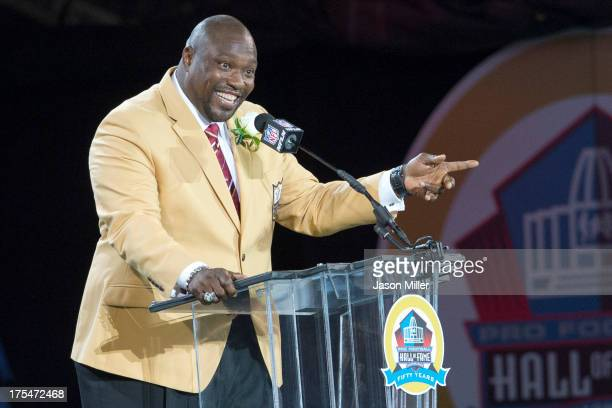 Former defensive tackle Warren Sapp of the Tampa Bay Buccaneers gives his speech during the NFL Class of 2013 Enshrinement Ceremony at Fawcett...