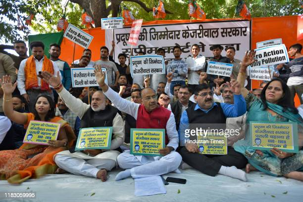 Former Delhi BJP president Vijay Goel along with his supporters shout slogans against Delhi chief minister Arvind Kejriwal for his alleged inaction...