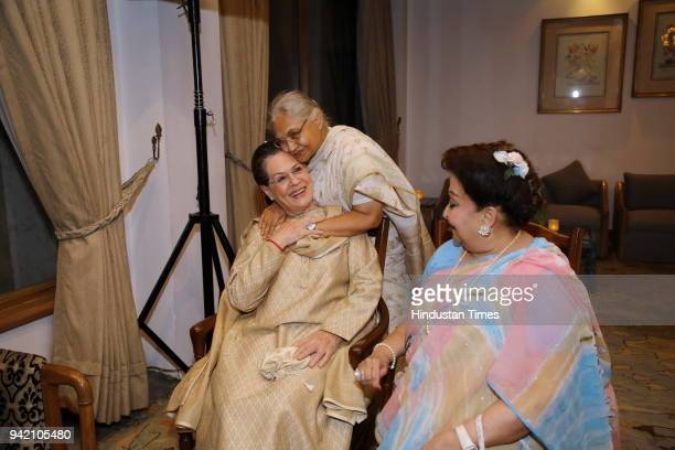 Former Delhi Chief Minister Sheila Dixit UPA chairperson Sonia Gandhi and Madhavi Raje Scindia during the launch of senior journalist columnist and...