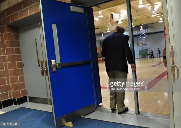 Former DeMatha basketball coach Morgan Wootten pauses before stepping into the gymnasium named after him in 1988 DeMatha officially opened their new...