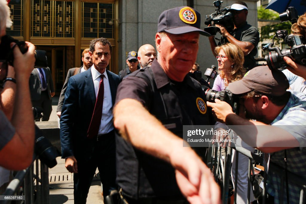 Former Democratic Congressman Anthony Weiner (L) exits federal court in Manhattan after pleading guilty in sexting case on May 19, 2017 in New York City. Weiner, who resigned from Congress over a sexting scandal, pleaded guilty on friday to federal charges of transmitting sexual material to a minor and could face a prison term.