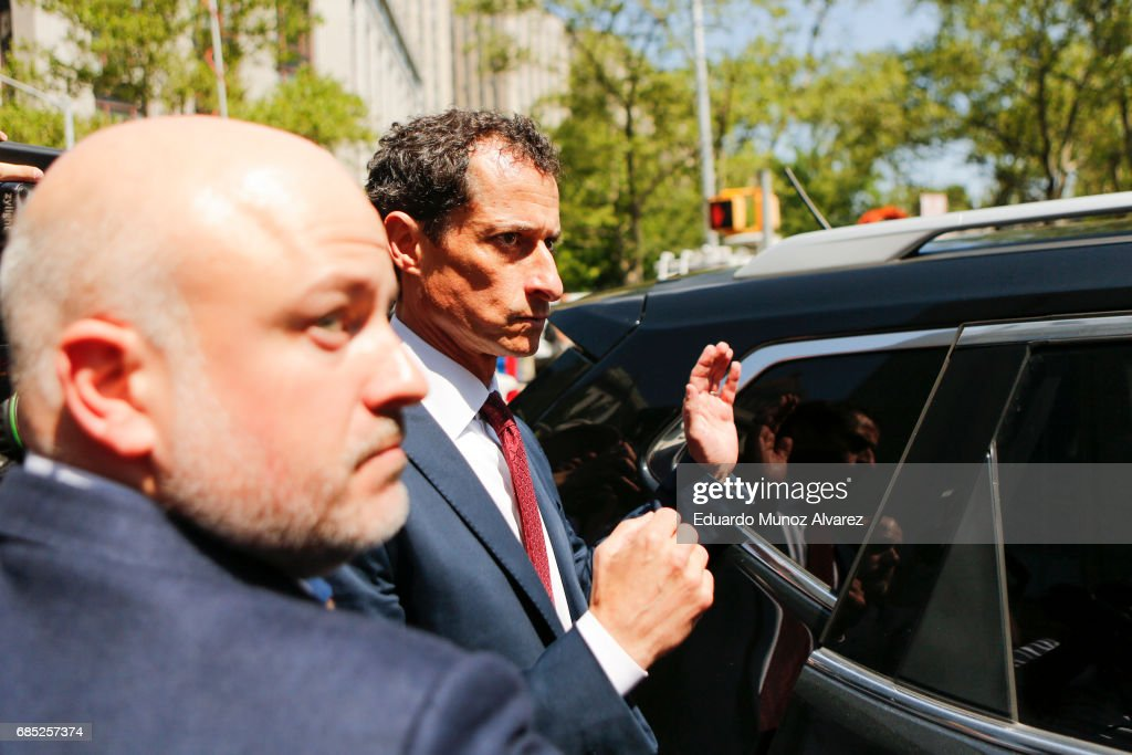 Former Democratic Congressman Anthony Weiner tries to get into his car while he exits federal court in Manhattan after pleading guilty in sexting case on May 19, 2017 in New York City. Weiner, who resigned from Congress over a sexting scandal, pleaded guilty on friday to federal charges of transmitting sexual material to a minor and could face a prison term.