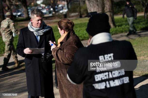 Former Democratic gubernatorial nominee James Smith talks with a woman as a man takes their photo during the annual Martin Luther King Jr Day at the...