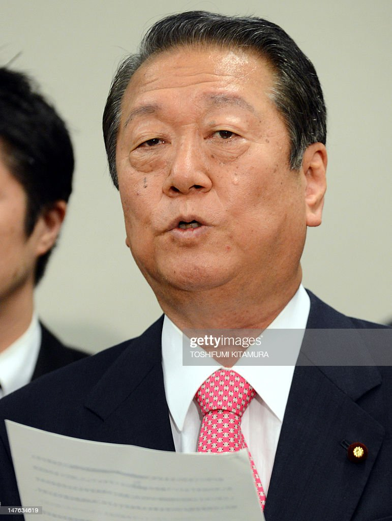 Former Democratic Party of Japan (DPJ) leader Ichiro Ozawa delivers a speech after submitting his resignation to the DPJ at the lower house members hall in Tokyo on July 2, 2012. 'Shadow Shogun' Ozawa and his 50-supporters stormed out of Japan's ruling party in protest at a sales tax hike, in a move that reduces, but does not overturn the government's majority.