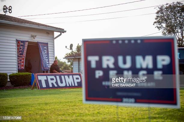 Former Democratic party voter and now fervent Trump supporter David Mitchko speaks during an interview with AFP outside his home covered with...