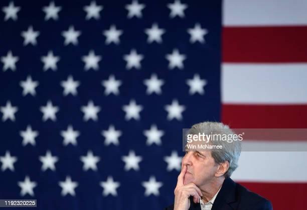 former Democratic presidential candidate John Kerry listens as Democratic presidential candidate former US Vice president Joe Biden speaks during a...