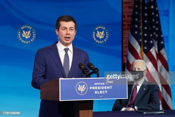 Former Democratic presidential candidate Pete Buttigieg speaks as U.S. President-elect Joe Biden looks on after he was nominated to be Secretary of...