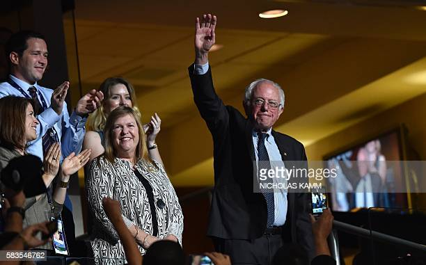 Former Democratic presidential candidate Vermont Senator Bernie Sanders waves during the roll call on Day 2 of the Democratic National Convention at...