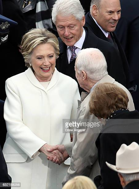 Former Democratic presidential nominee Hillary Clinton and former President Bill Clinton greet Former President Jimmy Carter and Rosalynn Carter on...