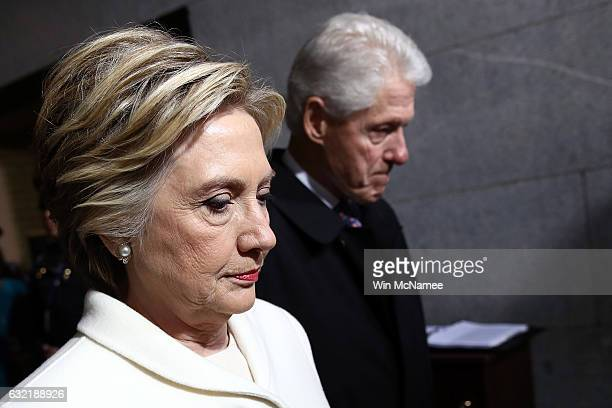 Former Democratic presidential nominee Hillary Clinton and former President Bill Clinton arrive on the West Front of the US Capitol on January 20...
