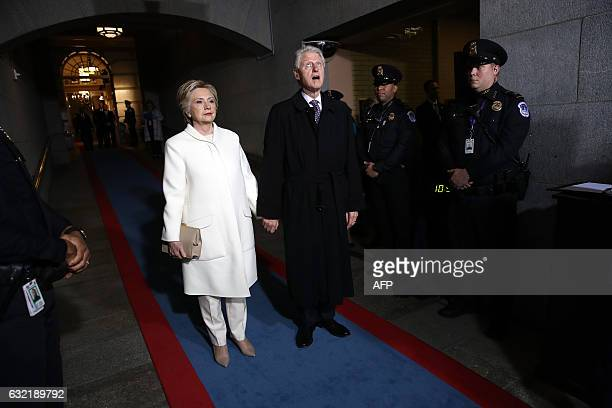 TOPSHOT Former Democratic presidential nominee Hillary Clinton and former US President Bill Clinton arrive on the West Front of the US Capitol on...