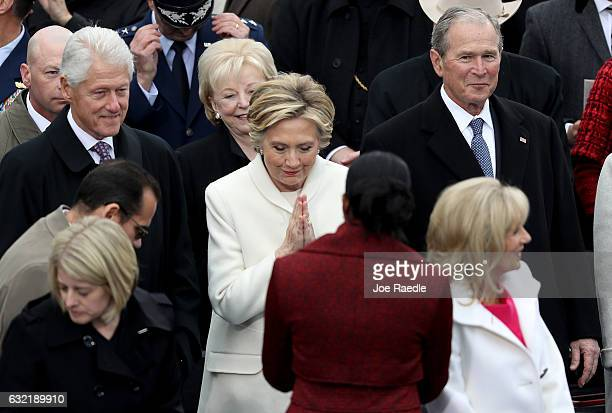 Former Democratic presidential nominee Hillary Clinton greets Michelle Obama as former President Bill Clinton and former President George W Bush look...