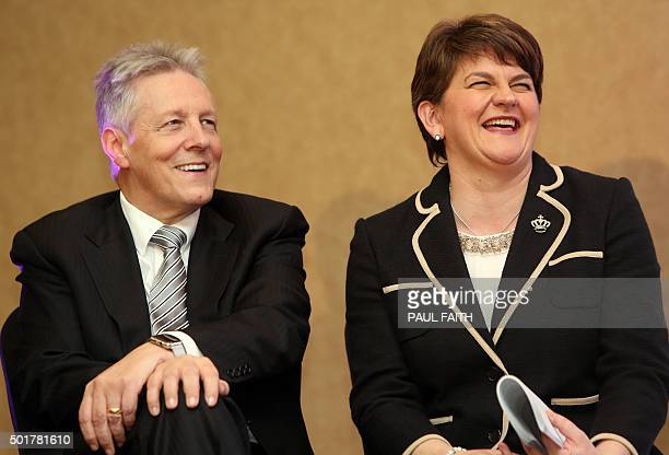 Former Democratic Unionist Party leader Peter Robinson shares a joke with the new leader Arlene Foster, Northern Ireland Finance Minister in Belfast...