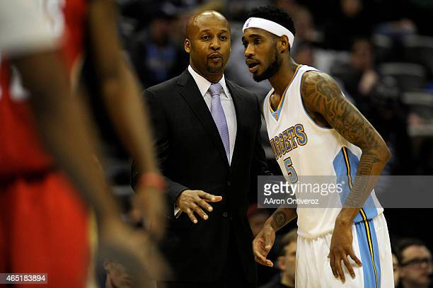 Former Denver Nuggets head coach Brian Shaw speaks with Will Barton during his final game at the helm in the second half of a 9992 loss to the New...