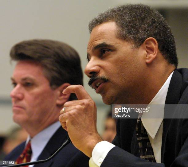 Former deputy attorney general Eric H Holder Jr right testifies as Jack Quinn attorney for fugitive financier Marc Rich and former White House...