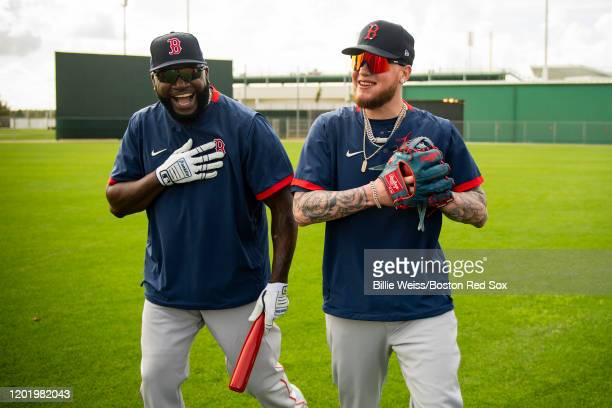 Former designated hitter David Ortiz of the Boston Red Sox reacts with Alex Verdugo of the Boston Red Sox during a team workout on February 20 2020...