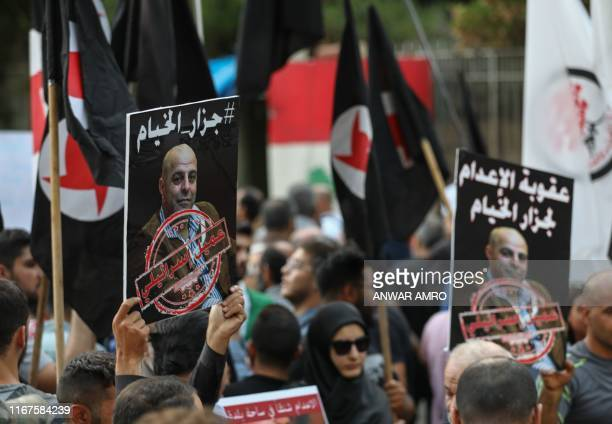 Former detainees of the proIsrael South Lebanon Army militia hold posters depicting former SLA member Amer alFakhoury during a demonstration...