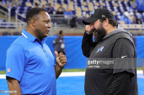 Former Detroit Lions Barry Sanders talks with Head Coach Matt Patricia prior to the start of the game against the Chicago Bears at Ford Field on...