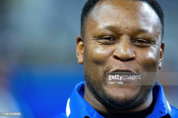 Former Detroit Lions Barry Sanders watches the action during the first quarter of the game against the Chicago Bears at Ford Field on November 28,...