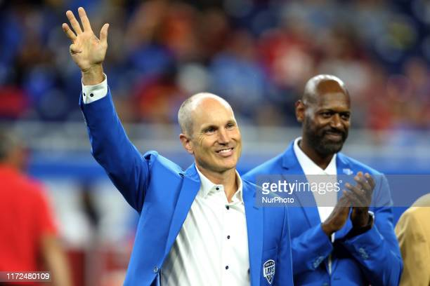 Former Detroit Lions kicker Jason Hanson is recognized during halftime of an NFL football game against the Kansas City Chiefs in Detroit, Michigan...