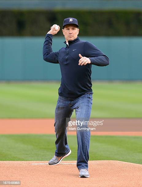 Former Detroit Lions kicker Jason Hanson throws out the ceremonial first pitch prior to the game between the Detroit Tigers and the Kansas City...