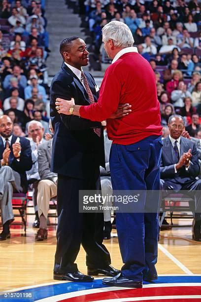 Former Detroit Pistons player Isiah Thomas and Indiana University Head Coach Bob Knight hug during his jersey retirement ceremony on March 18 1996 at...