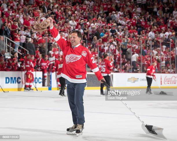 Red octopus getty images former detroit red wing dino ciccarelli twirls an octopus that was thrown on the ice during voltagebd Images