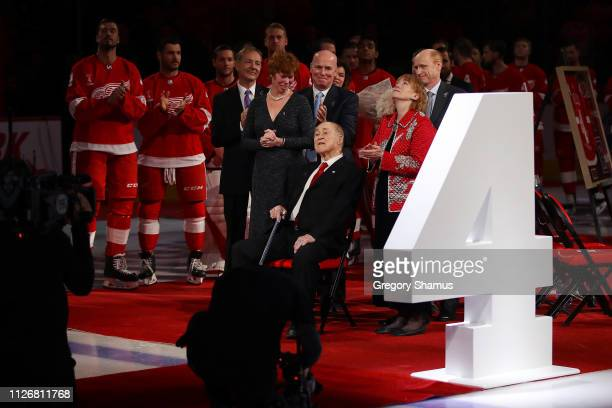 Former Detroit Red Wing Red Kelly along with his family watch his being raised to the rafters after being retired prior to a game against the Toronto...