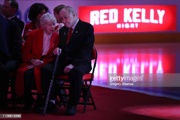 Former Detroit Red Wing Red Kelly talks to his wife Andra during a ceremony to retire his Kelly's prior to a game against the Toronto Maple Leafs at...