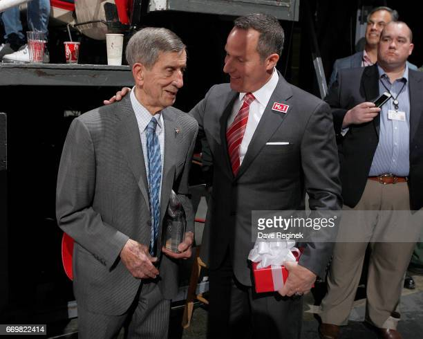 Former Detroit Red Wing Ted Lindsay talks with Christopher Ilitch President and CEO of Ilitch Holdings Inc before pregame ceremonies prior to the...