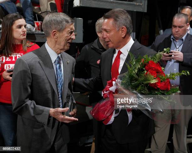 Former Detroit Red Wing Ted Lindsay talks with Ken Holland General Manager and executive Vice President of the Detroit Red Wings before pregame...