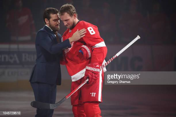 Former Detroit Red Wings captain Henrik Zetterberg shakes hands with Justin Abdelkader after a ceremonial puck drop prior to playing the Columbus...