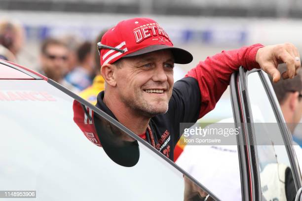 Former Detroit Red Wings player and Honorary Pace Car Driver Darren McCarty poses for photographs before the start of the Monster Energy NASCAR Cup...