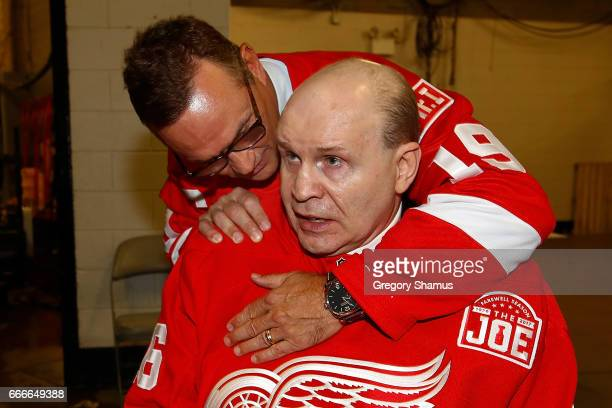 Former Detroit Red Wings Steve Yzerman and Vladimir Konstantinov embrace after a ceremony honoring Joe Louis Arena on April 9 2017 in Detroit...