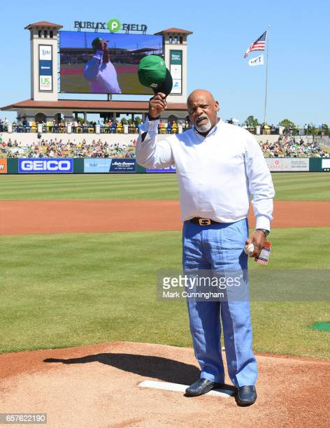 Former Detroit Tigers first baseman Cecil Fielder waves to the crowd before throwing out the ceremonial first pitch prior to the Spring Training game...