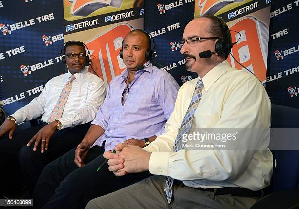 Former Detroit Tigers infielder Carlos Guillen talks in the television booth with Tigers TV broadcasters Rod Allen and Mario Impemba during the game...