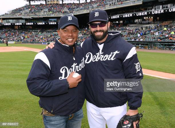 Former Detroit Tigers infielder Ramon Santiago poses for a photo with Alex Avila of the Detroit Tigers prior to the game against the Chicago White...