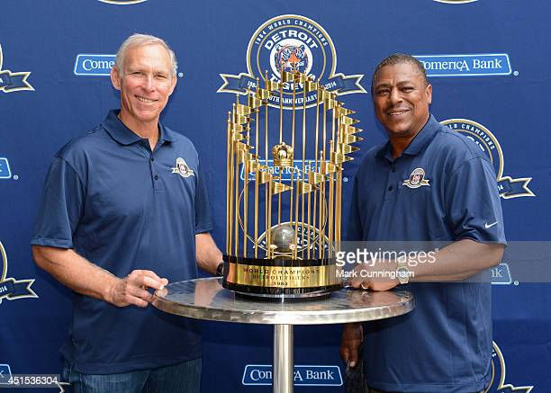 Former Detroit Tigers infielders Alan Trammell and Lou Whitaker pose for a photo with the 1984 World Championship trophy prior to the game against...