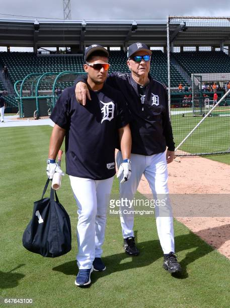 Former Detroit Tigers outfielder and Baseball HallofFamer Al Kaline and Jose Iglesias of the Detroit Tigers walk together on the field prior to the...