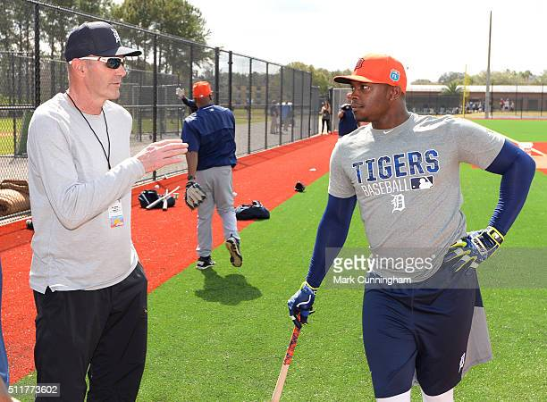 Former Detroit Tigers outfielder Kirk Gibson talks with Justin Upton of the Detroit Tigers during the Spring Training workout day at the TigerTown...