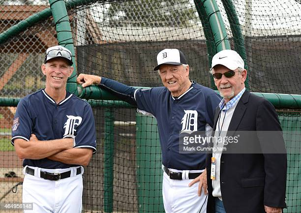 Former Detroit Tigers players Alan Trammell Al Kaline and former manager Jim Leyland pose for a photo at the batting cage during the Detroit Tigers...