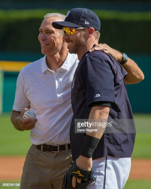 Former Detroit Tigers shortstop Alan Trammell throws out the ceremonial first pitch to Andrew Romine of the Tigers and pose for a picture before a...