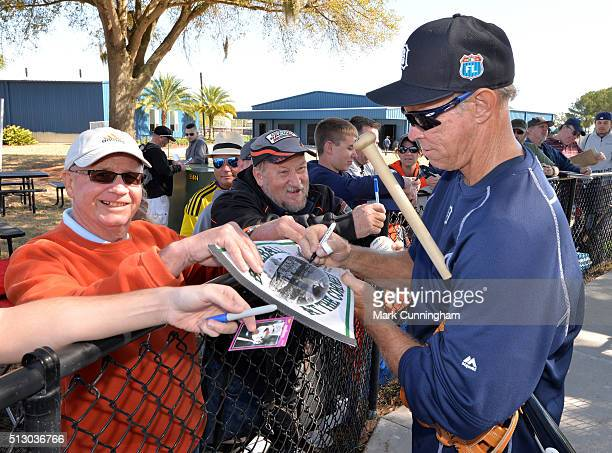 Former Detroit Tigers shortstop and current coach Alan Trammell signs autographs during the Spring Training workout day at the TigerTown Facility on...