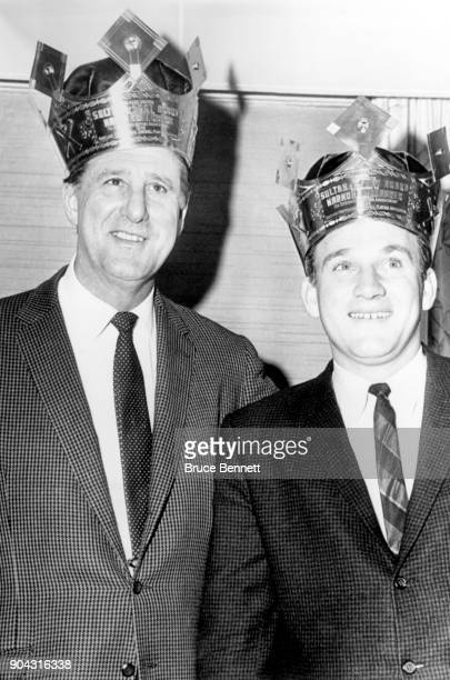 Former Detroit Tigers star Hank Greenberg and Harmon Killebrew of the Minnesota Twins pose with the 'Sultan of Swat' crown for the most homeruns...